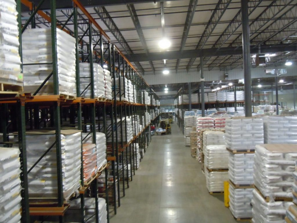 Warehouse Interiors with Shelves, pallets and boxes