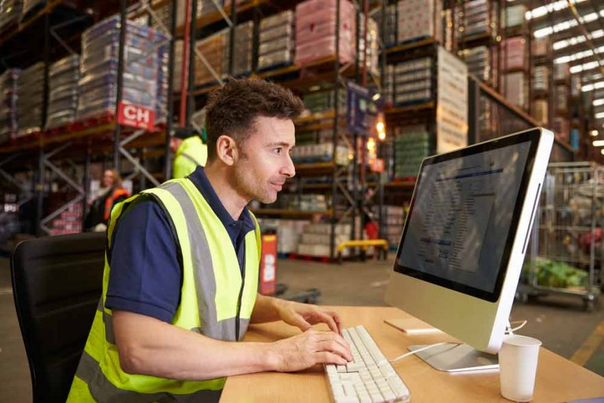 Image of a male labour working in a warehouse